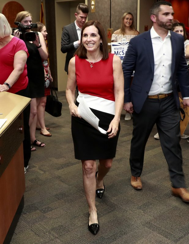 Women running for office have crossed another threshold with a record number of candidates for the U.S. Senate. In the two major parties, 42 women are expected to have qualified for 19 Senate seats. (Source: AP Photo/Matt York)