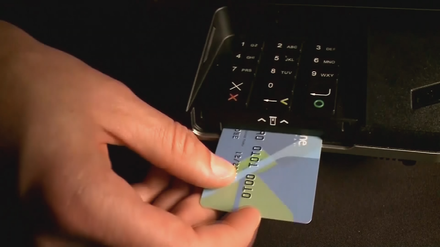 What scammers are doing is they're inserting a super thin device into the part where you insert your credit card, like the slot, and they are stealing your credit card information. (Source: 3TV/CBS 5)