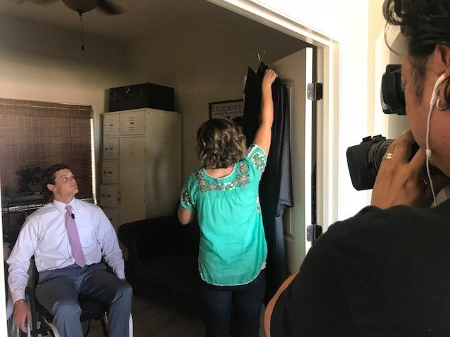 Colton puts on his cap and gown at his home before heading off to his Imagine Prep Surprise graduation. (Source: 3TV/CBS 5)