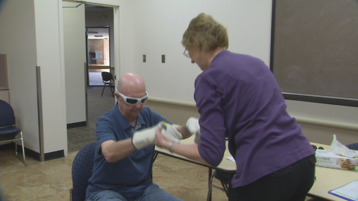 A participant prepares for Tempe's Alzheimer's and dementia experience class. (Source: 3TV/CBS 5)
