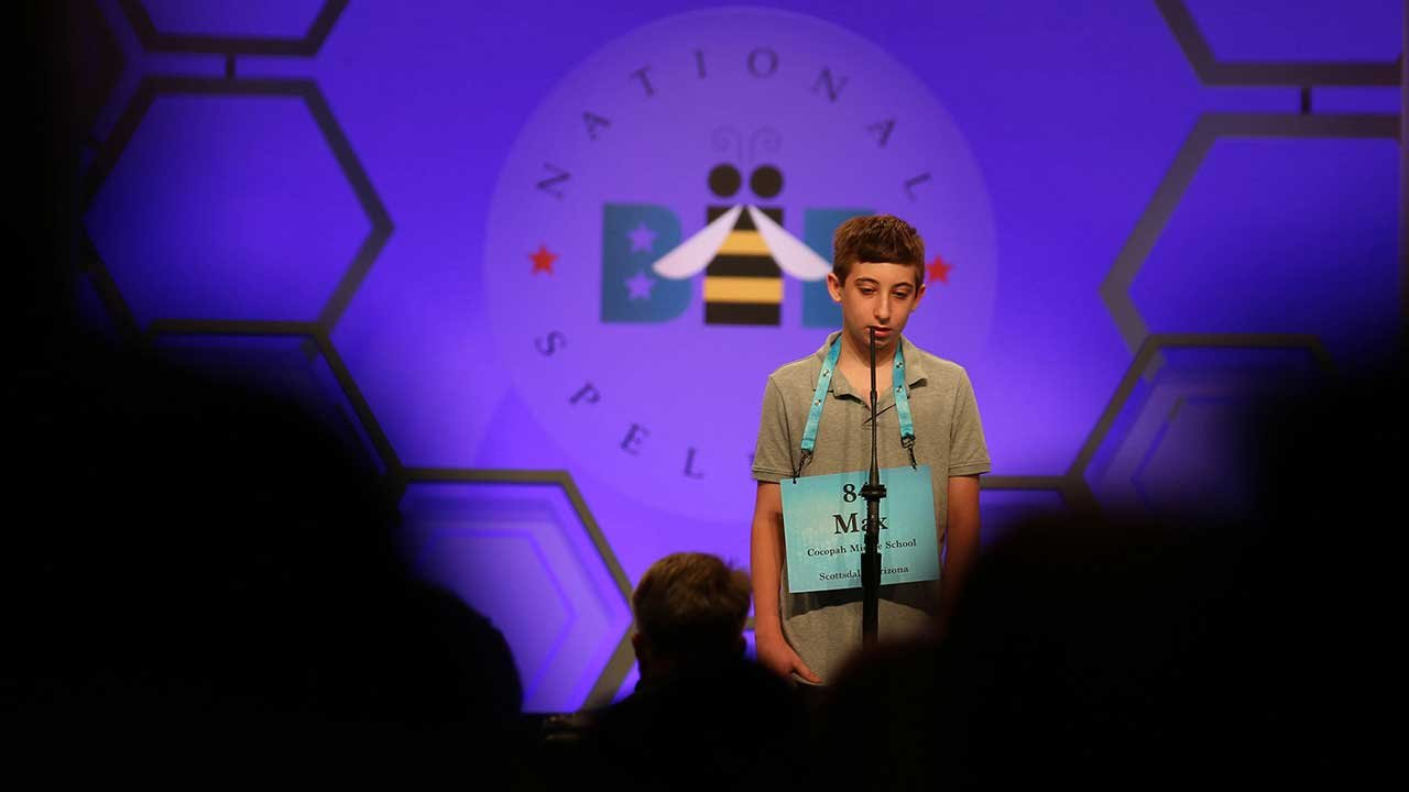 "Cocopah Middle School sixth-grader Max Greenspan carefully – and correctly – spells out the word ""misdemeanant"" during the third round of the spelling bee on Wednesday. (Source: Bryan Pietsch/Cronkite News)"