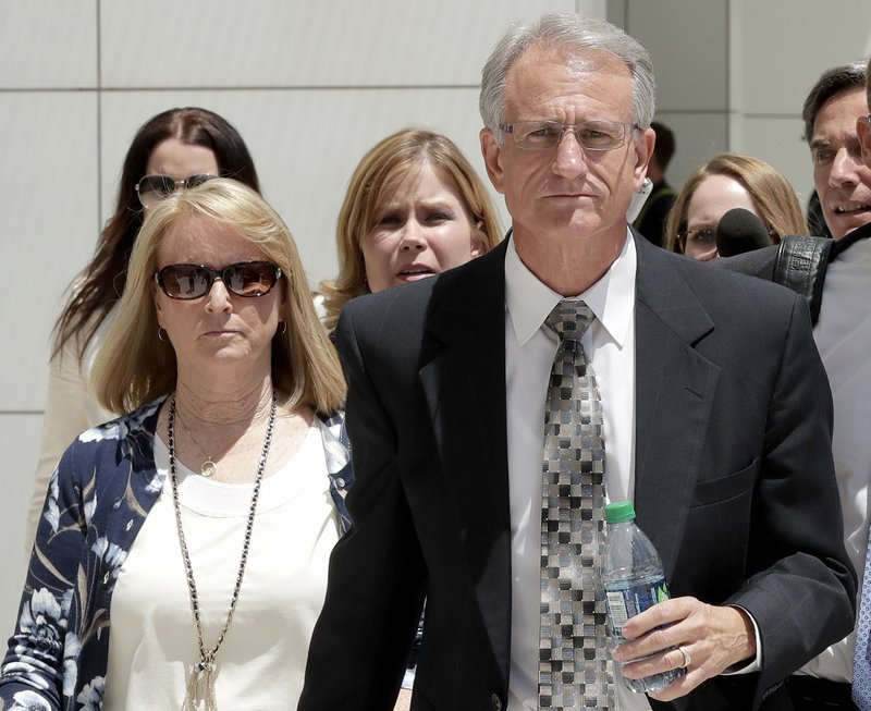FILE - In this June 7, 2017 file photo former Arizona Corporation Commissioner Gary Pierce, and his wife Sherry, left, leave court in Phoenix after being arraigned on bribery and fraud charges. (Source: AP Photo/Matt York, File)