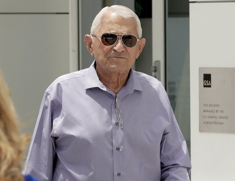 FILE - In this June 7, 2017 file photo developer George Johnson leaves Federal Court after being arraigned on bribery and fraud charges, in Phoenix. (Source: AP Photo/Matt York, File)