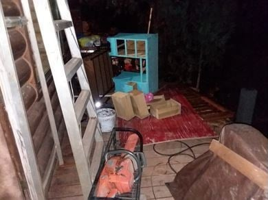 The bear knocked a desk on its side on the porch and pulled out the drawers. (Source: AZ Game & Fish)