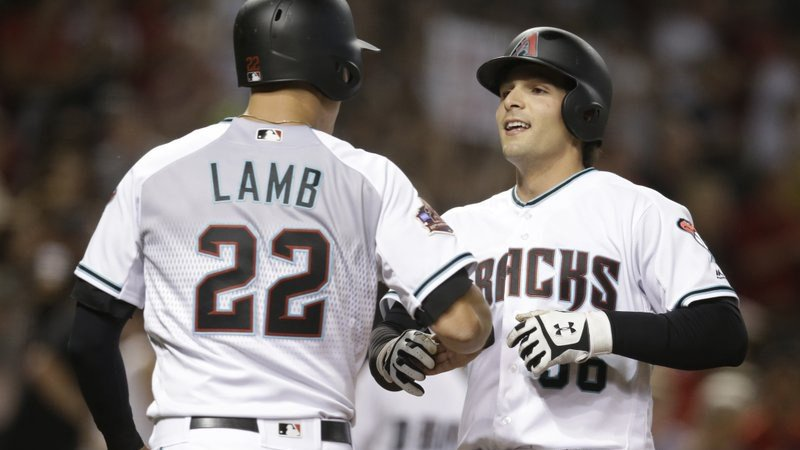 Arizona Diamondbacks' John Ryan Murphy celebrates with Jake Lamb (22) after hitting a two-run home run against the Miami Marlins during the fifth inning during a baseball game Friday, June 1, 2018, in Phoenix. (Source: AP Photo/Rick Scuteri)