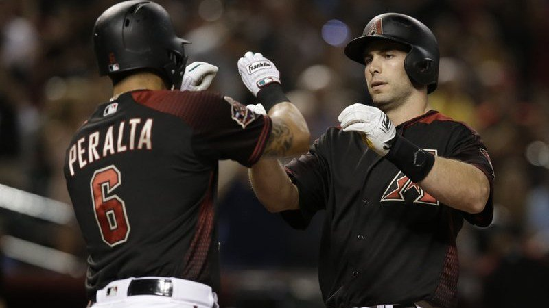 Arizona Diamondbacks' Paul Goldschmidt, right, celebrates with David Peralta (6) after hitting a solo home run against the Miami Marlins in the first inning of a baseball game, Saturday, June 2, 2018, in Phoenix. (Source: AP Photo/Rick Scuteri)