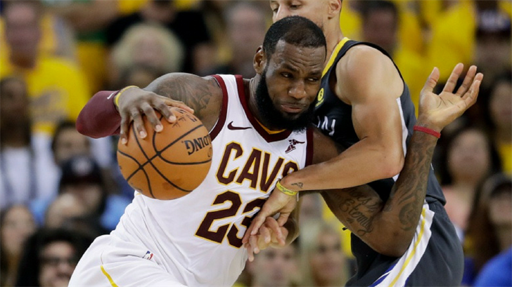 Cleveland Cavaliers forward LeBron James (23) drives against Golden State Warriors guard Stephen Curry during the first half of Game 2 of basketball's NBA Finals in Oakland, Calif., Sunday, June 3, 2018. (Source: AP Photo/Marcio Jose Sanchez)