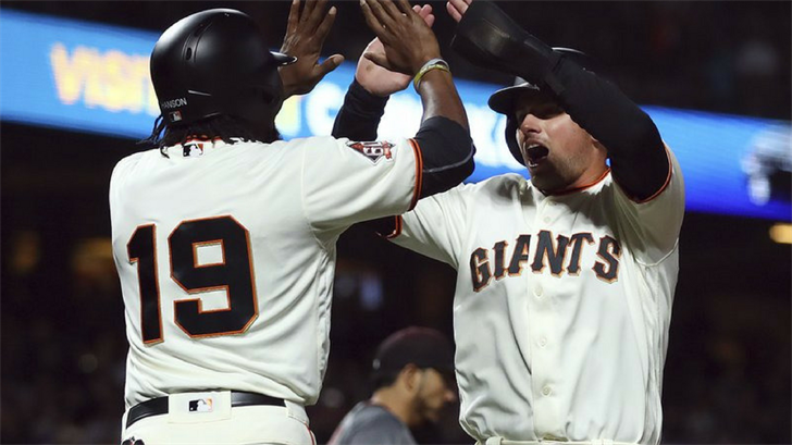 Andrew McCutchen and Brandon Crawford opened a seven-run fourth inning with back-to-back home runs, and the San Francisco Giants got back to .500 on the season by beating the first-place Arizona Diamondbacks 10-3 on Monday night. (Source: AP Photo)