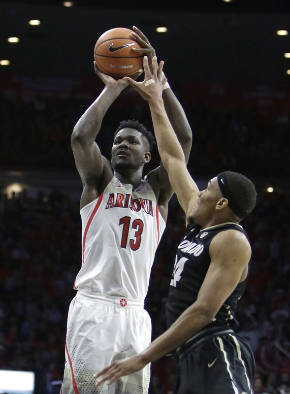 FILE - In this Jan. 25, 2018, file photo, Arizona forward Deandre Ayton (13) shoots in the second half during an NCAA college basketball game against Colorado, in Tucson, Ariz. (Source: AP Photo/Rick Scuteri, File)