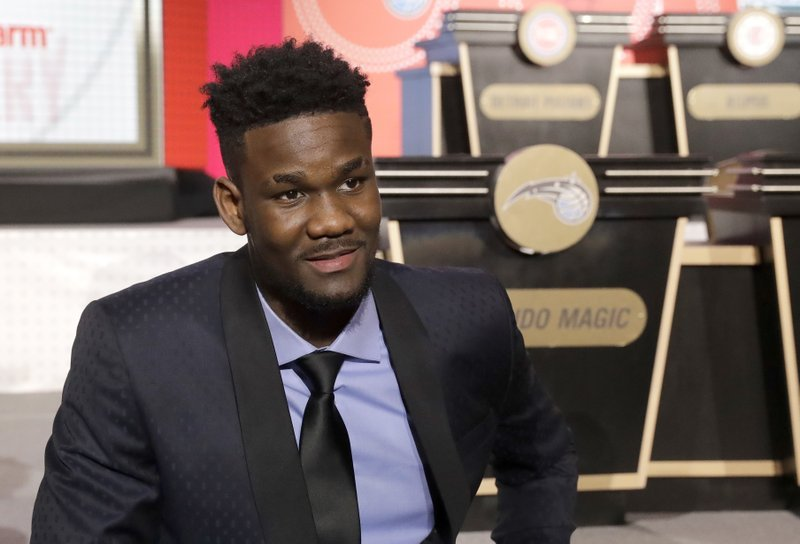 FILE - In this May 15, 2018, file photo, DeAndre Ayton sits on the stage before the NBA basketball draft lottery in Chicago. Ayton could be the Phoenix Suns choice with the no. 1 pick in this month's NBA Draft. (Source: AP Photo/Charles Rex Arbogast, File
