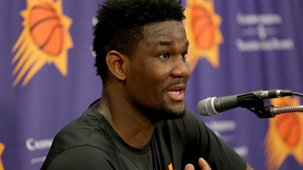 NBA Draft prospect Deandre Ayton, who may be the Phoenix Suns' choice with the No. 1 overall pick in this month's NBA draft, talks to the media after an individual workout with the Suns, Wednesday, June 6, 2018 in Phoenix. (Source: AP Photo/Matt York)