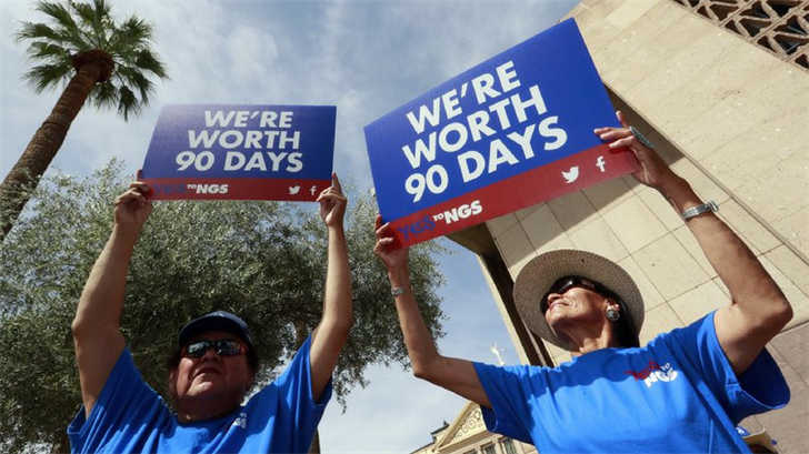 Roger Parrish and Diane Johnson, right, rally outside the Capitol in Phoenix, Wednesday, June 6, 2018. (Source: AP Photo/Matt York)
