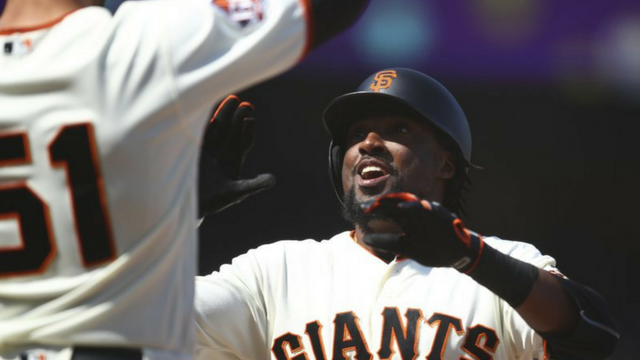 San Francisco Giants' Alen Hanson, right, celebrates with Mac Williamson (51) after hitting a two run home run off Arizona Diamondbacks' Brad Boxberger in the ninth inning of a baseball game Wednesday, June 6, 2018, in San Francisco. (Source: AP Photo)