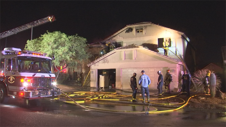 Firefighters extinguished a fire in a large two-story home near Tatum Boulevard and Cave Creek Road. (Source: 3TV/CBS 5)