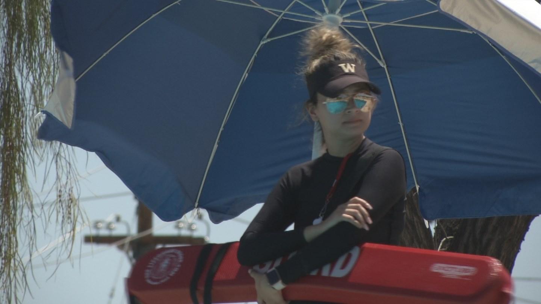 A lifeguard keeps watch over swimmers. (Source: 3TV/CBS 5 News)