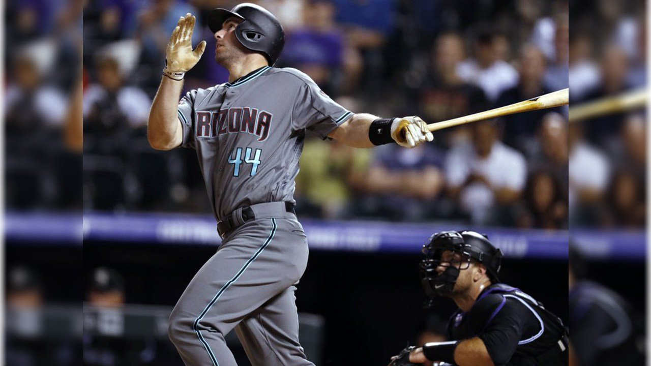 Arizona Diamondbacks' Paul Goldschmidt watches his solo home run off Colorado Rockies relief pitcher Brooks Pounders during the ninth inning of a baseball game Friday, June 8, 2018, in Denver. Arizona won 9-4. (Source: AP Photo/David Zalubowski)