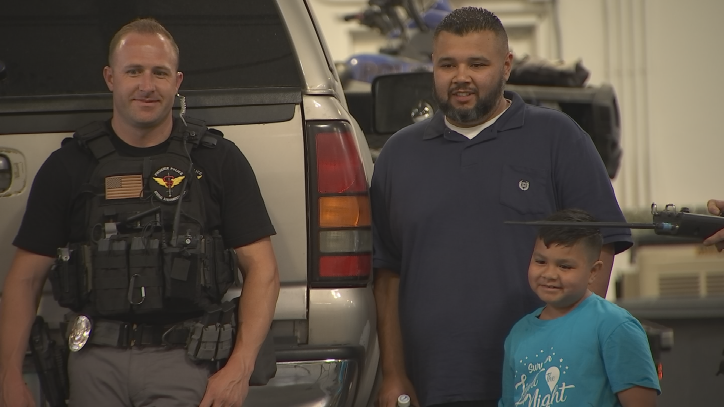 Freddy Herrera with his son Julian hung out with Phoenix SWAT officers Wednesday. (Source: 3TV/CBS 5)