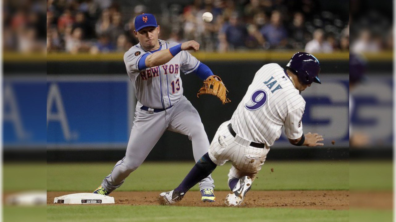 New York Mets' Asdrubal Cabrera (13) throws to first after forcing out Arizona Diamondbacks' Jon Jay (9) on a double play hit into by Nick Ahmed during the fifth inning of a baseball game Thursday, June 14, 2018, in Phoenix. (Source: AP Photo/Matt York)