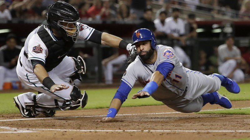 New York Mets' Jose Bautista is tagged out at the plate by Arizona Diamondbacks catcher Alex Avila while trying to score on a fly ball hit by Amed Rosario during the second inning of a baseball game Friday, June 15, 2018, in Phoenix. (AP Photo/Matt York)