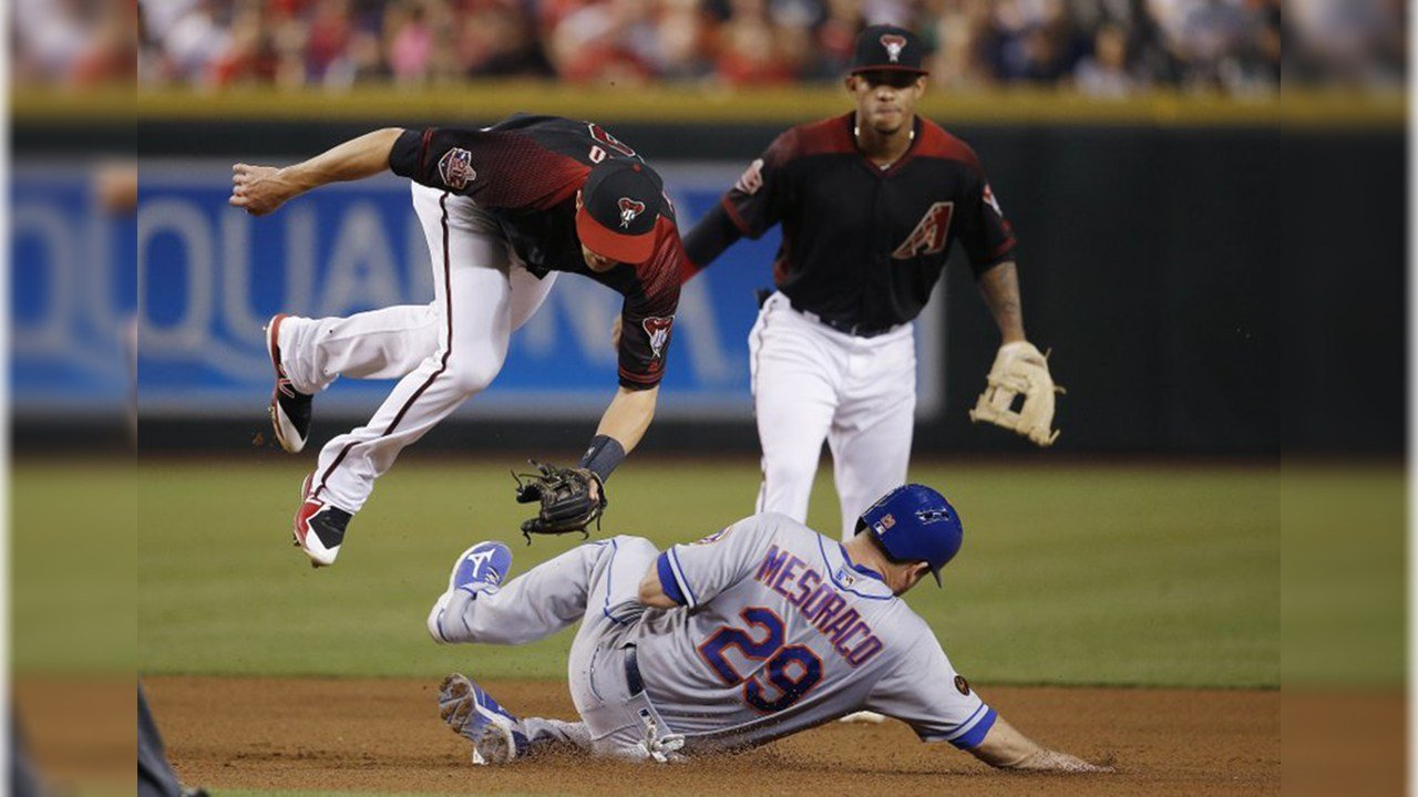 New York Mets' Devin Mesoraco (29) upends Diamondbacks shortstop Nick Ahmed, left, after Mesoraco was forced out at second base as Diamondbacks' Ketel Marte, back right, watches during the fourth inning Saturday, June 16, 2018. (AP Photo/Ross D. Franklin)