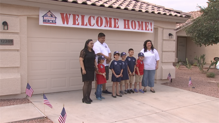 Bitsui family in front of their new home. (Source: 3TV/CBS5)