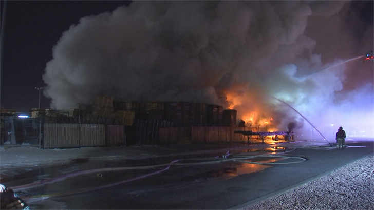 Upon their arrival, firefighters immediately balanced the fire to a first-alarm with several other pallets catching fire. (Source: 3TV/CBS 5)