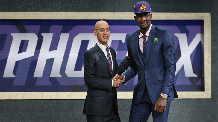 (Source: AP Photo/Kevin Hagen)Arizona's Deandre Ayton, right, poses with NBA Commissioner Adam Silver after he was picked first overall by the Phoenix Suns during the NBA basketball draft in New York, Thursday, June 21, 2018. (Source: AP Photo/Kevin Hagen