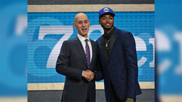 Villanova's Mikal Bridges, right, poses with NBA Commissioner Adam Silver after he was picked 10th overall by the Philadelphia 76ers during the NBA basketball draft in New York, Thursday, June 21, 2018. (Source: AP Photo/Kevin Hagen)