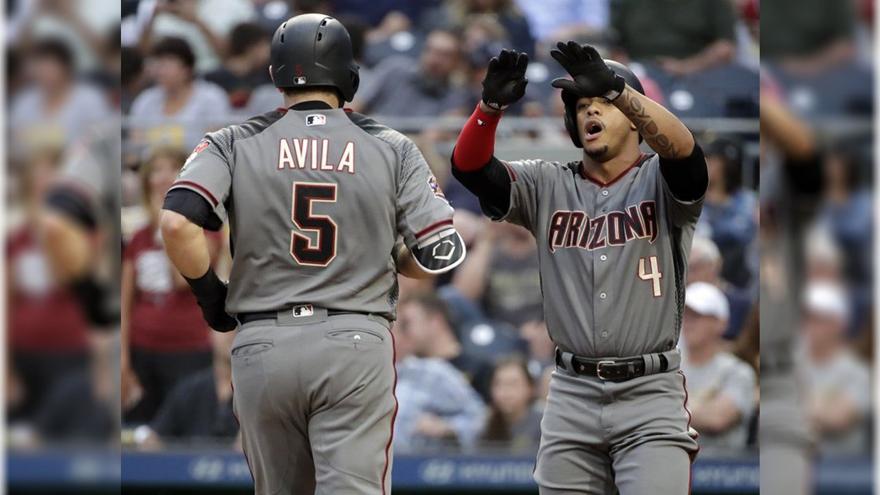 Diamondbacks' Alex Avila (5) is greeted by Ketel Marte (4) after hitting a two-run home run off Pittsburgh Pirates starting pitcher Chad Kuhl during the third inning of a baseball game in Pittsburgh, Thursday, June 21, 2018. (AP Photo/Gene J. Puskar)