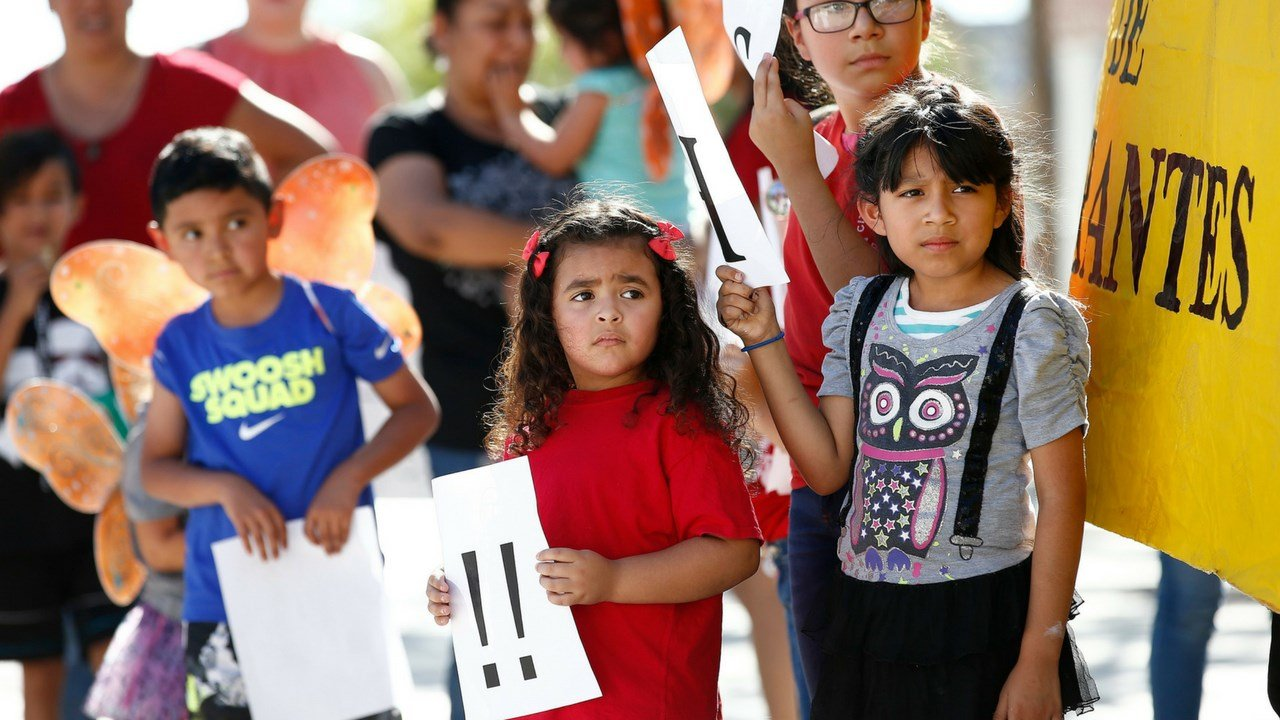 Children listen to speakers during an immigration family separation protest in front of the Sandra Day O'Connor U.S. District Court building, Monday, June 18, 2018, in Phoenix. (AP Photo/Ross D. Franklin)