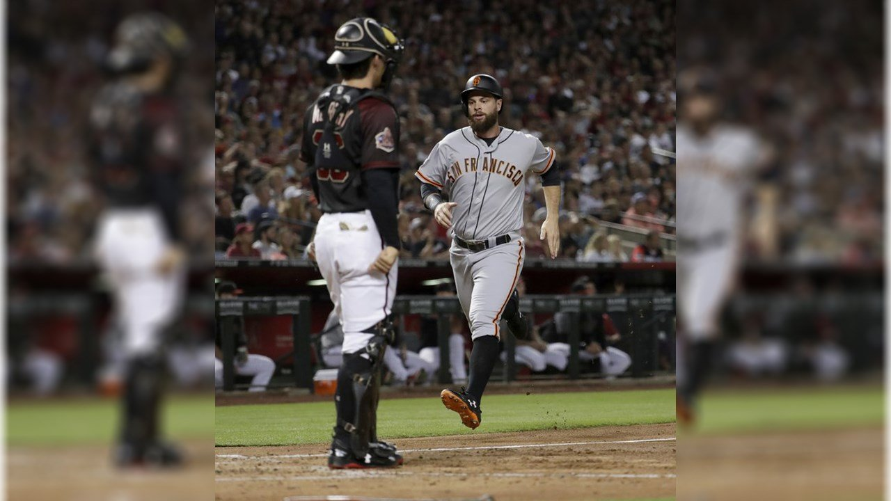 San Francisco Giants' Brandon Crawford scores on a base hit by Pablo Sandoval during the third inning of a baseball game against the Arizona Diamondbacks, Saturday, June 30, 2018, in Phoenix. (Source: AP Photo/Matt York)