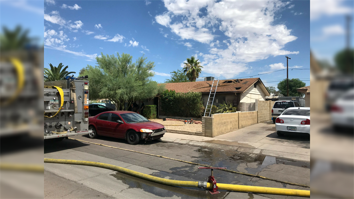 The fire was sparked by torching vegetation around the home. (Source: Phoenix Fire Dept.)