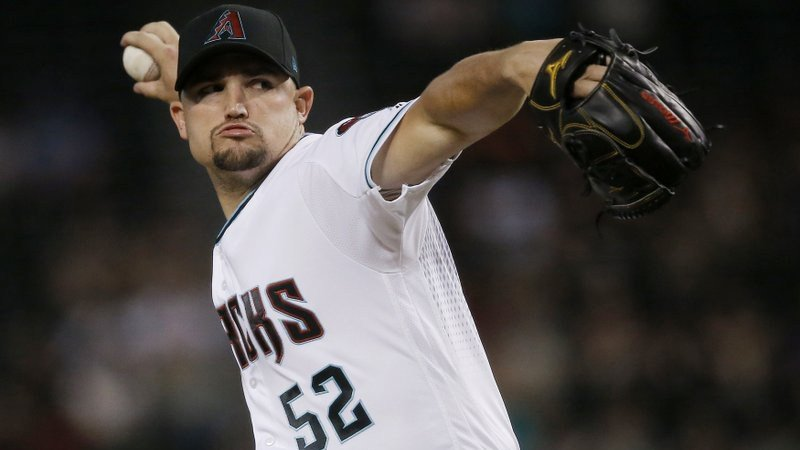 Arizona Diamondbacks starting pitcher Zack Godley throws against the San Diego Padres during the first inning of a baseball game Friday, July 6, 2018, in Phoenix. (Source: AP Photo/Ross D. Franklin)