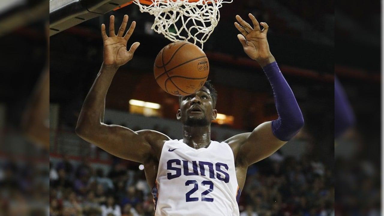 Phoenix Suns' Deandre Ayton dunks against the Dallas Mavericks during the second half of an NBA summer league basketball game Friday, July 6, 2018, in Las Vegas. (Source: AP Photo/John Locher)