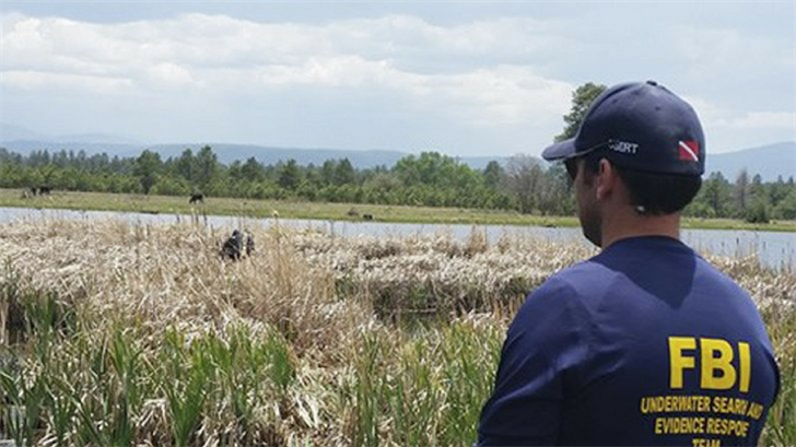 "FBI agents conduct a search in and around a pond for Katherine ""Kat"" Tortice in McNary, Ariz. (Federal Bureau of Investigation via AP)"
