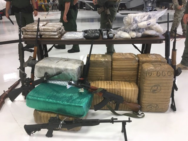 Some of the contraband seized by the Border Strike Force was on display at the press conference. (Source: 3TV/CBS 5)