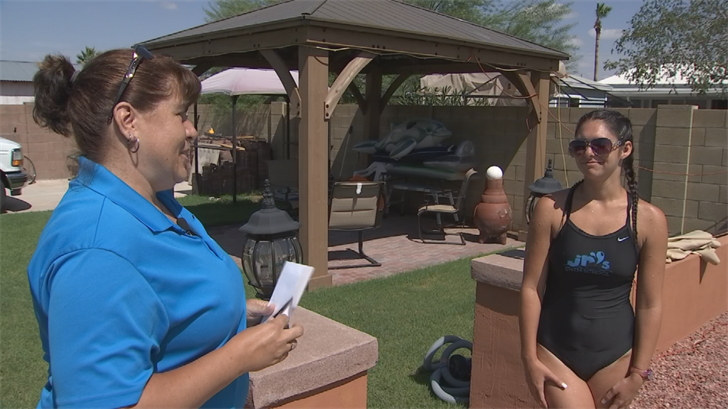 CBS 5 followed along when Scott surprised Cordeiro during one of her swim lessons and gave her $500. (Source: CBS 5)