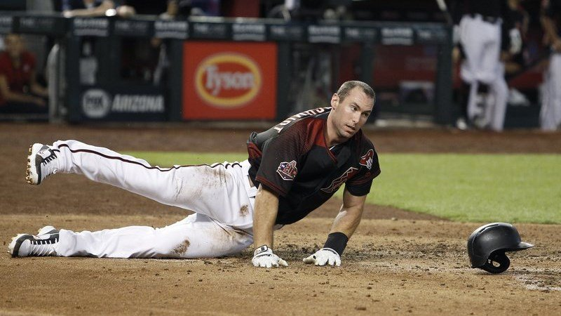 Diamondbacks' Paul Goldschmidt loses his helmet as he slide across home plate to score against the Colorado Rockies on a sacrifice fly by Nick Ahmed during the fourth inning of a baseball game Saturday, July 21, 2018, in Phoenix. (AP Photo/Ralph Freso)
