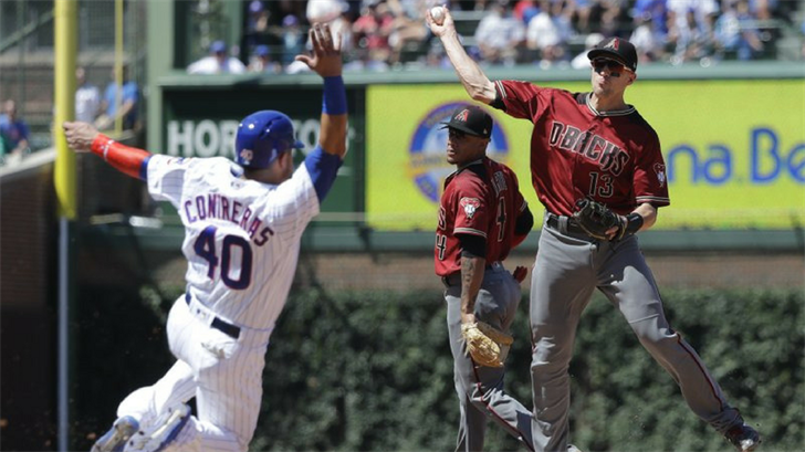 Arizona Diamondbacks' Nick Ahmed, right, turns a double play after forcing out Chicago Cubs' Willson Contreras at second base during the fourth inning of a baseball game Wednesday, July 25, 2018, in Chicago. (Source: AP Photo/Charles Rex Arbogast)