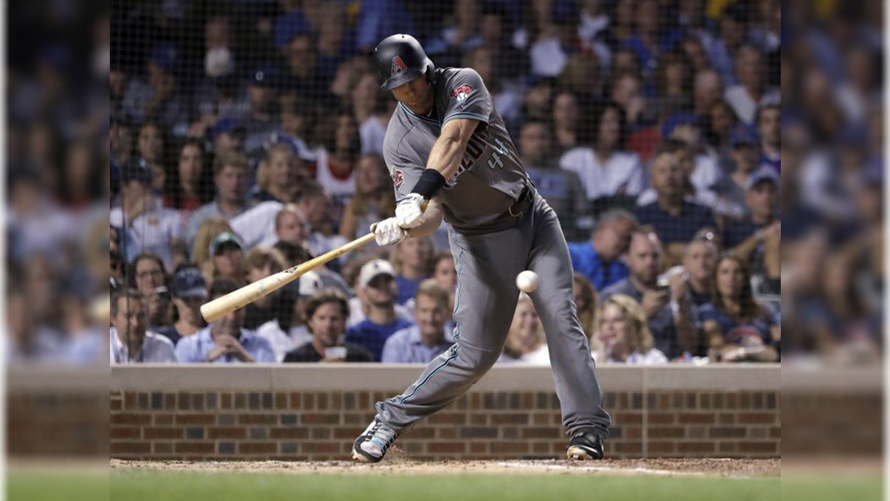 Arizona Diamondbacks' Paul Goldschmidt hits an RBI single off Chicago Cubs starting pitcher Kyle Hendricks during the fifth inning of a baseball game Tuesday, July 24, 2018, in Chicago. Jon Jay scored. (Source: AP Photo/Charles Rex Arbogast)
