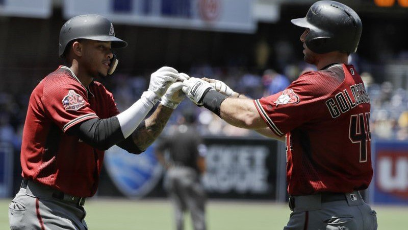 Arizona Diamondbacks' Paul Goldschmidt, right, is greeted by teammate Ketel Marte, left, after hitting a two-run home run during the first inning of a baseball game Sunday, July 29, 2018, in San Diego. (Source: AP Photo/Gregory Bull)