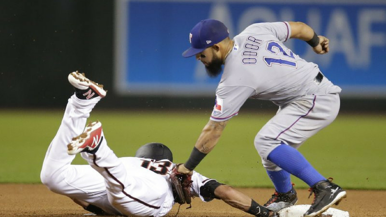 Arizona Diamondbacks Nick Ahmed dives back into second base safely under the tag of Texas Rangers second baseman Rougned Odor in the fourth inning during a baseball game, Monday, July 30, 2018, in Phoenix. (Source: AP Photo)