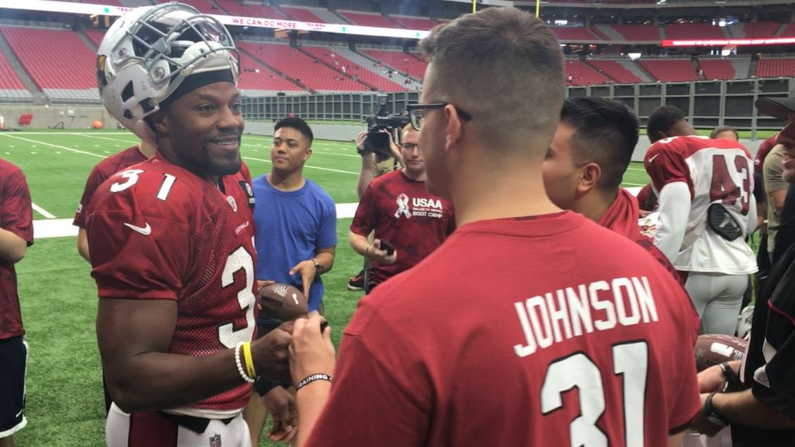 David Johnson and his Arizona Cardinals teammates took the field for practice on Wednesday through a tunnel of local military members. (Source: 3TV/CBS 5)