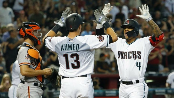 Arizona Diamondbacks Ketel Marte (4) celebrates with Nick Ahmed after hitting a two-run home run against the San Francisco Giants in the first inning during a baseball game, Saturday, Aug. 4, 2018, in Phoenix.(Source: AP Photo/Rick Scuteri)