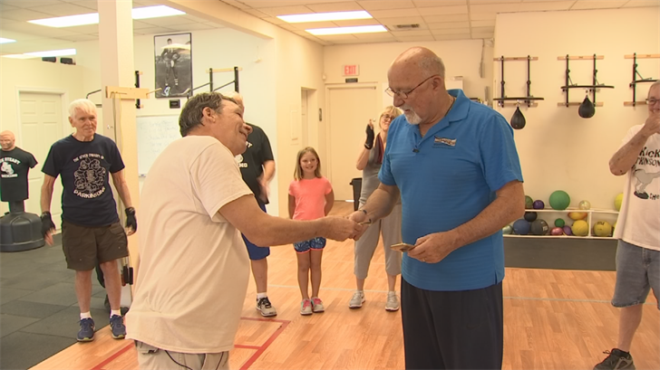 Stevenson and some other Rock Steady boxers gathered together last month to surprise their instructor and give him $500. (Source: CBS 5)
