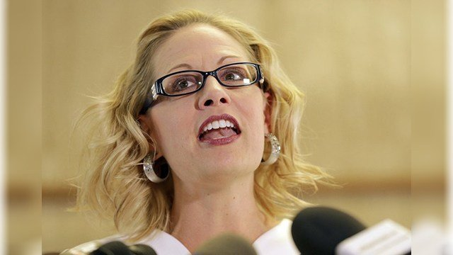 FILE - In this May 29, 2018, file photo, Rep. Kyrsten Sinema, D-Ariz. speaks prior to delivering her signatures to the Arizona Secretary of State's office at the Capitol in Phoenix. (Source: AP Photo/Matt York, file)