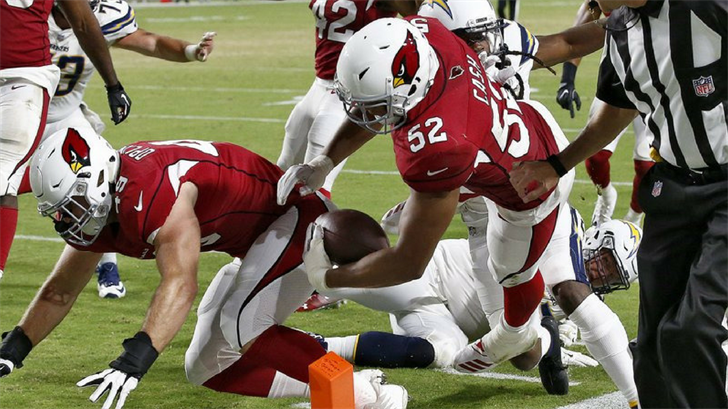 Arizona Cardinals linebacker Jeremy Cash (52) runs back a fumble recovery for a touchdown against the Los Angeles Chargers. (Source: AP Photo/Ross D. Franklin)