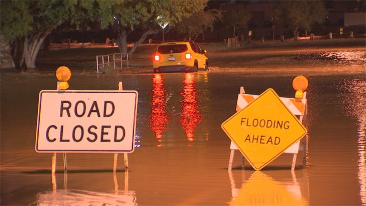 "The driver ignored the ""road closed"" and ""flooding ahead"" signs. (Source: 3TV/CBS 5)"