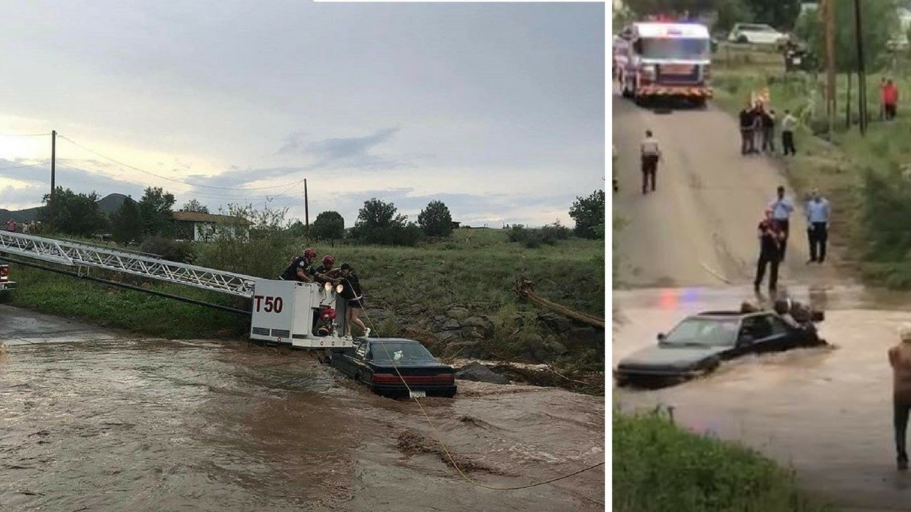 Rescuers pull a woman from flooded wash after she became stuck. (Source: Yavapai County Sheriff Dept.)