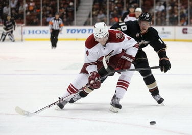 ANAHEIM, CA - NOVEMBER 06: Zbynek Michalek #4 of the Phoenix Coyotes is pursued by Corey Perry #10 of the Anaheim Ducks for the puck in the first period at Honda Center on November 6, 2013 in Anaheim, California. (Photo by Jeff Gross/Getty Images)  Read m